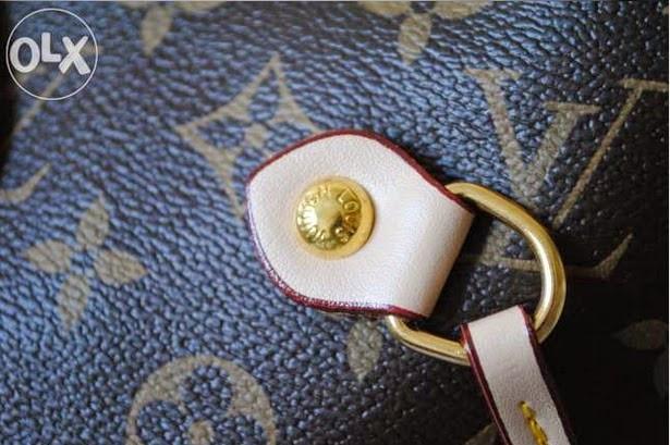 Jak rozpoznac podrobke Neverfull Louis Vuitton skora